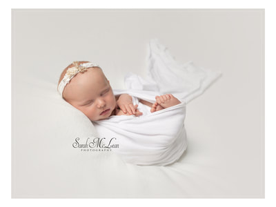 newborn baby swaddled in a wrap photo's in Clitheore , Preston, Chorley Lancashire