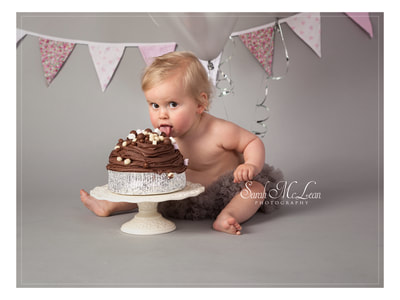 first birthday cake smash photoshoot in leyland lancashire by Sarah Mclean