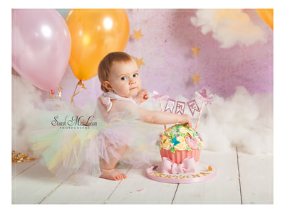 rainbow unicorn themed cake smash photography session in Preston, Lancashire by Sarah Mclean