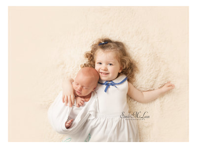 baby and sister professional photography in Clitheroe Preston Lancashire by Sarah McLean Photography