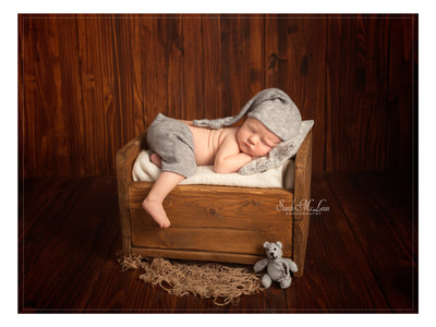 newborn baby on a bed. Photos by Sarah Mclean Photography