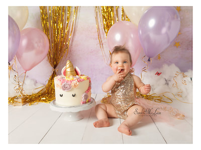 unicorn first birthday cake smash photos by Sarah Mclean in Chorley, Lancashire